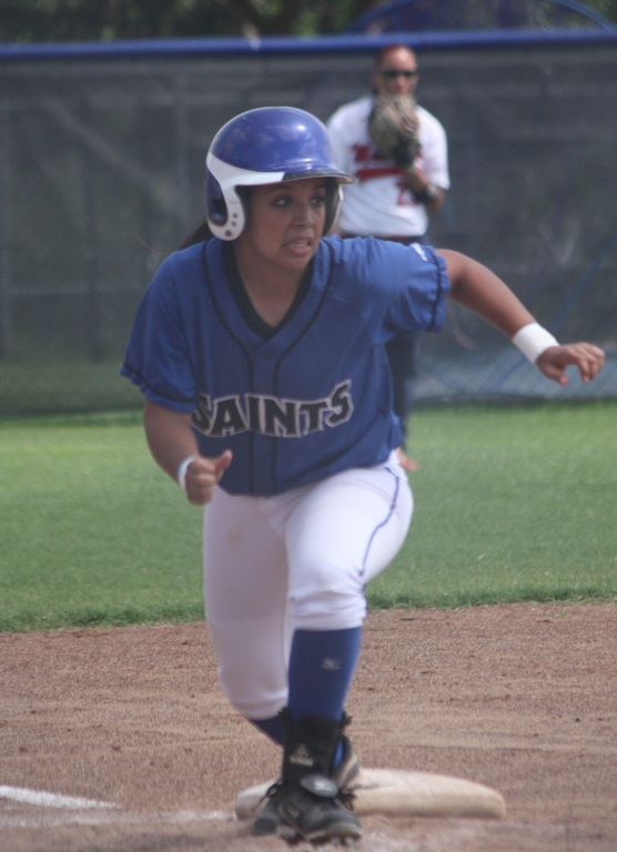 Julie Ramos prepares to score after hitting her first career triple.