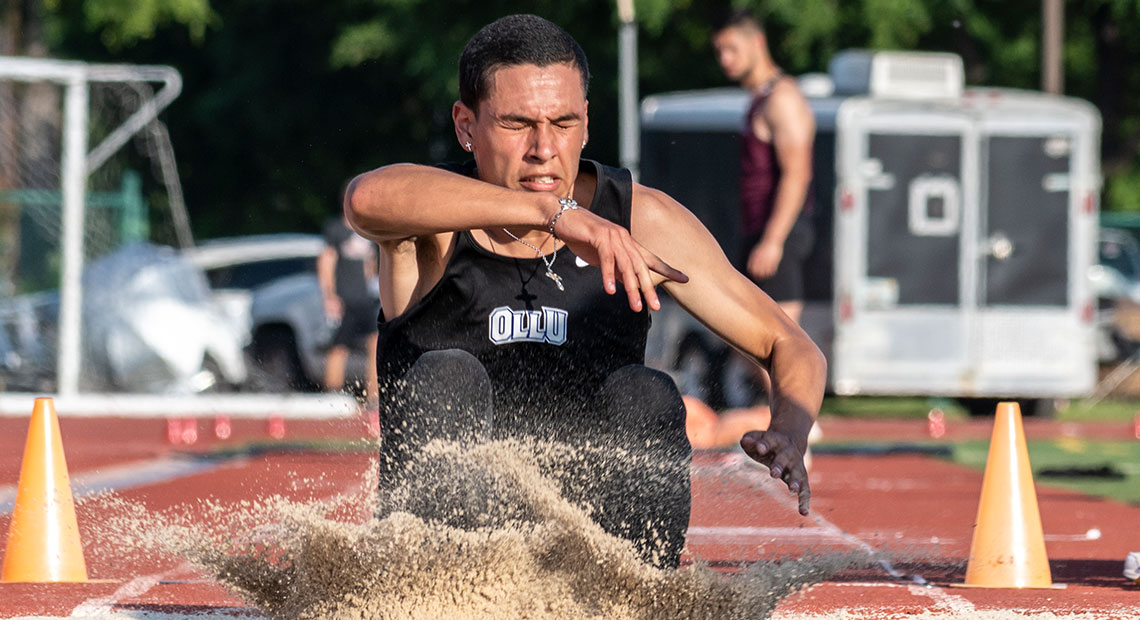 Pablo Cavazos participates in the long jump.