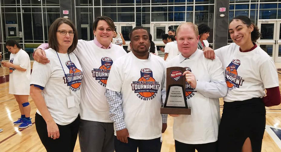 The coaching staff celebrate and pose with the 2019 trophy (photo courtesy Stacy Stephens).