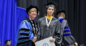 Soccer's Gabriela Colina is one of two athletes who received OLLU's highest honor at graduation.